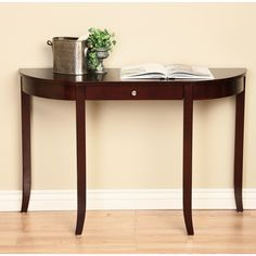 Store keys or other small items in this wooden console table that doubles as chic decorative furniture. Richly finished in cherry walnut, this elegant table features one convenient storage drawer, slim tapered legs, and silver-toned accents.