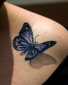 """Corrine Skeen, from Baltimore, has a butterfly tattoo. """"I wanted it to look like there's a real butterfly sitting on my shoulder."""" (Photo: Matt Roth for The New York Times) Realistic Butterfly Tattoo, Purple Butterfly Tattoo, Butterfly Tattoo Meaning, Butterfly Tattoos For Women, Butterfly Tattoo Designs, Butterfly Colors, Butterfly Shoulder Tattoo, Watercolor Butterfly Tattoo, Best 3d Tattoos"""