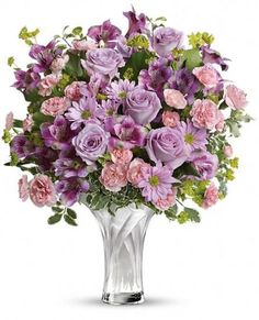 This elegant arrangement of pink and purple blooms is beautifully arranged in our Celebrate Mom glass vase. Its simply stunning!