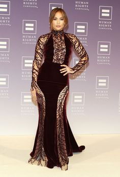 """J.Lo Gets Political. Jennifer Lopez knows how to rock a red carpet.Whether the """"Hit the Floor"""" crooner is sporting a bod-baring ballgownor a conservative, poufy skirt, J.Lo reigns supreme when it comes to making red-carpet statements.  Check her out here wearing a curve-accentuating Zuhair Murad couture gown at the 2013 HRC National Dinner, and more of J.Lo's hottest looks,right here!"""