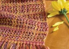 Learn how to weave leno lace with this 4-shaft weaving project.