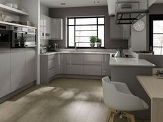 Remo is a gloss lacquered handle-free   kitchen available in alabaster, beige,   grey and white. #KBHomes