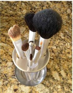 Store your makeup brushes in a toothbrush holder.