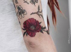 Red poppy tattoo by Olga Nekrasova