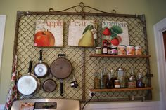 Upcycle old fence gate + S hooks = kitchen pegboard