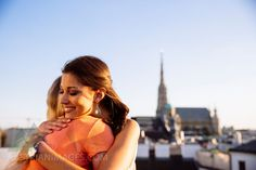 Austria, Vienna, two happy friends embracing on roof terrace with stephansdom in the background Happy Friends, Vienna, Austria, Terrace, Girlfriends, Hug, Rooftop Terrace, Destinations, Traveling