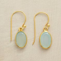 """RIMMED CHALCEDONY EARRINGS--In these golden rimmed chalcedony earrings, the simplest rims of 18kt goldplated silver allow light to reveal the incandescent, pale aqua color of faceted chalcedony gems. French wires. 1-1/8""""L."""