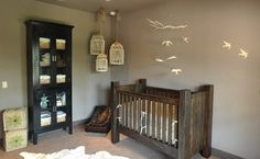 Vintage touches like the refurbished crib and hanging birdcages give this nursery a warm & comfortable feel.