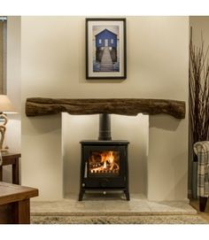 Newman Fireplaces Oak Effect Stone Beams - Fowey Empty Fireplace Ideas, Fireplace Beam, Log Burner Fireplace, Rustic Fireplace Mantels, Brick Fireplace Makeover, Wood Burner, Living Room With Fireplace, Fireplace Design, Cosy Fireplace