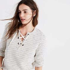 Effortlessly cool, this striped pullover has a low-key nautical vibe thanks to the lace-up neckline. Crafted of cozy, textural terry, it can stand in for a jacket on those what-season-is-it-anyway days. <ul><li>Boxy fit.</li><li>Cotton.</li><li>Machine wash.</li><li>Import.</li></ul>