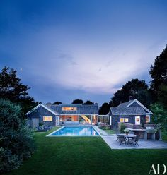 Local landscape designer Stan Stokowski oversaw the grounds. The poolside chaise longues and the table and chairs on the terrace are all by Barlow Tyrie | archdigest.com