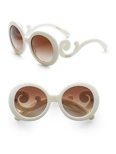 Prada Baroque Sunglassess ($290)Sophisticated design in a round shape with lavish baroque accents.