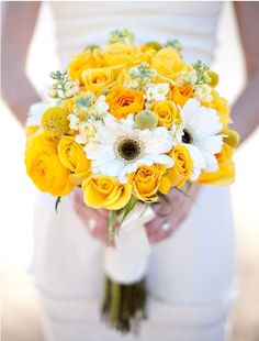 Yellow and white bouquet.. daisies, roses, ranunculus, scabiosa (billy buttons) and berries.