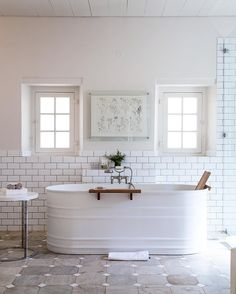 Painted water trough turned bathtub. Not insulated, no slope to recline, no jets... but I like the look.