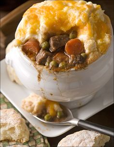Guinness Beef Shepherd's Pie: It's all about Ireland's famous black stout in this recipe for Guinness Beef Shepherd's Pie. Slow simmered, fork-tender. Topped with savory mashed potatoes.