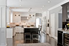 White Cabinets, Grey Walls, Black Accents, Dark Wood Floors