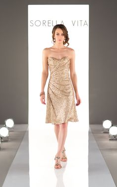 Sparkling sequin bridesmaid gowns add the perfect amount of glamour to your wedding day style! Featuring a romantic sweetheart neckline and sweet side ruching, this cocktail length gown is also available in floor length as Style 8794.