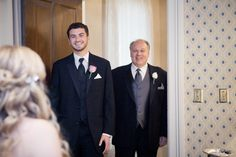 First look with father and brother of the bride