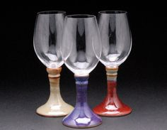 Wine glasses with ceramic stems.
