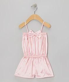 This soft and pretty satin romper was made for those fancy-schmancy days. Topped off with a darling bow, it has stretchy elastic at the neckline and waist to provide a comfy fit for little movers and shakers. PolyesterHand wash; hang dryImported