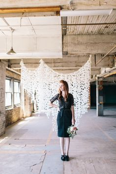 Do you all remember this weddingand the crazy good backdrop that created quite the internet commotion? Stunning and totally DIY if you can believe it. Well we stalked the Bride and her awesomely talented designer friend, Katie M Kulperand begged