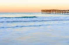 Pacific Beach Dawn Photograph by Priya Ghose - Pacific Beach Dawn Fine Art Prints and Posters for Sale. - Dawn colors the soft turquoise waves flowing up onto Pacific Beach in San Diego, California, and lights up the edge of Crystal Pier. #sandiego #photography #ocean #waves