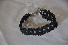 tutorial for tatting a lace bracelet with beading. Love the square tatting shapes. MUST try this one out!!