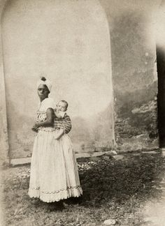 19C slavery and using images to understand it | NPR| Black woman with white child on her back. Bahia, 1860.