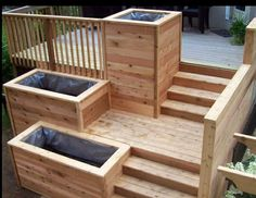 Built in planters are nice. Maybe two or three from the top level and contemporary railings starting at the main deck? We also discussed doing a built in planter at the edge of the main level to plant trees for privacy.                                                                               More