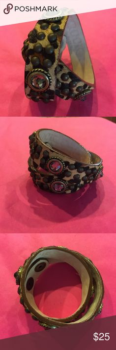 Leatherock wrap bracelet Cheetah print pony hair leather. Light gray Swarovski crystals and bronze studs. Hand tooled work. A very noticeable accessory. Adjustable size. Bracelets are new and never worn, but missing tags. Leatherock Jewelry Bracelets