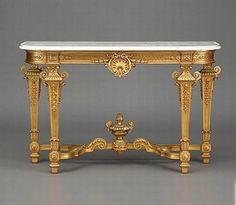 Louis XVI Console Table. Symmetry and surface decoration are two characteristics that make it Louis XVI.