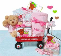 It's A Girl Wagon Gift Set -Announcing the arrival of a brand new baby girl!  This adorable It's A Girl Baby Wagon full of keepsake baby gifts announces her entry into the world with lots of great stuff the new mom and dad will love! http://www.storkbabygiftbaskets.com/its-a-girl-wagon-gift-set.html  $119.95