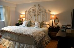 Love the old gate as headboard