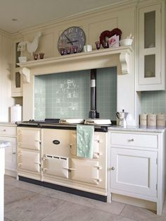 BACKSPLASH LOVE this glossy colored tile brings just the right pop to the kitchen. kinda retro no?
