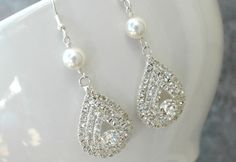 These would be the perfect accessary for a wedding dress! Diamonds and pearls--a lethal combination!