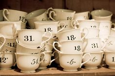INSPIRATION :: Numerical Mugs (look more like tea cups to me...) from Anthro. Transfer (or even paint if you've got a steady hand) numbers onto plain what tea cups.