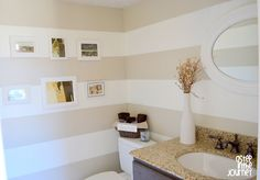 Horizontal stripes in bathroom.  Colors used: Behr's Jasmine White and Castle Stone