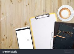 Top View Of Stuff Office Desktop And Copy Space. Analyze Data Chart Show On Paper And Tablet, Planner Notebook, Glasses And…