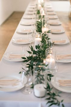 Minimal Garland with Candle Centerpiece // wedding, all white, feasting table, head table, tablescape, greenery #WeddingIdeasCenterpieces