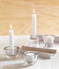 clever: reversible candle holders are double drilled for taper candles and tealights. chunky, clear glass