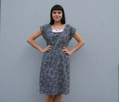 1950s abstract blue wiggle dress with bow trim