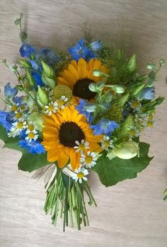 Beautiful summer bouquet in blue and yellow with sunflowers, daisy, delphinium. By Plantology Florist, Sheffield, UK www.plantologyflorist.co.uk: