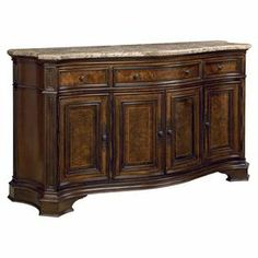 """Display antique finds and fresh florals on this marble-topped credenza. Artfully crafted from wood with traditional carved details, this elegant design offers ample storage with 3 drawers and 4 doors.    Product: SideboardConstruction Material: Laurel Burl veneer, marble and select hardwoodsColor: CherryFeatures: Intricate detailingDimensions: 40"""" H x 68"""" W x 23"""" D"""