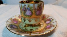 "Hand Painted ""Love Story"" Footed Tea Cup and Saucer from Germany"