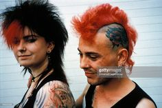 1980 Punk couple, one with dyed red mohican, tattooed head and piercing and other with red and black bushy hair, UK. Bushy Hair, Piercing, Dreadlocks, Punk, Nose Rings, Couples, Tattoos, 1990s, Hair Styles