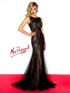 Floor length black dresses are great for the pageant stage or any social event! The Mac Duggal pageant dress 50187R is a beautiful black dress with a beaute neckline that sits on top of a fitted silhouette. The layered black tulle skirt adds a touch of old Hollywood glam to this lovely evening gown!
