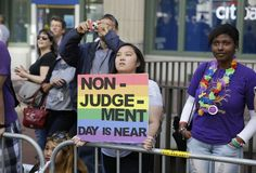 Eliza Galimba, 16, holds up a sign while watching the 44th annual San Francisco Gay Pride parade Sunday, June 29, ...