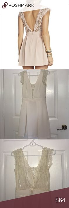 BCBG Genetration lace V back dress New only worn to one event , a first communion. Beautiful lace detail and the open back is fenomenal it is the same dress as the first image with the model but in ivory like a pearl white creamy color BCBGeneration Dresses Mini