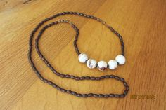 Necklace with five white, brown marbled pocelain beads and faceted czech glass beads.  $30 www.etsy.com/shop/casanoni