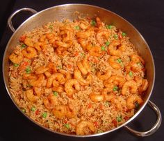 Skillet Shrimp and Rice I usually add a can of clams to this, and use instant brown rice, cover it and finish on the stove top.